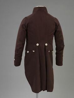 Court suit, 1810-1820: Splendid cut-steel buttons are the only decoration on the coat. They were made of flat circles of polished steel decorated with faceted steel rivets, set to sparkle and reflect the light. These were a fashionable style of button in the late 18th century which continued to be worn with court dress well into the 1870s.
