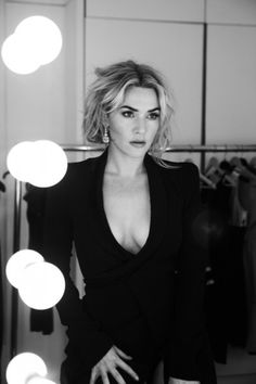 Kate Winslet is gorgeous showing off her cleavage in a low cut jacket in this black and white photo. #Kate_Winslet #cleavage