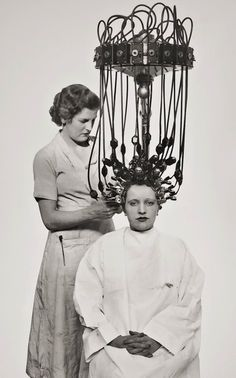 1935.  (My mother talked about her first permanent--which involved one of these machines.  She was a teenager and was scared to death the entire time that the beauty shop would catch fire and she wouldn't be able to get out...slj