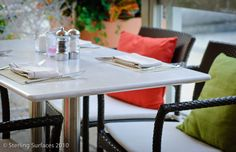 Outdoor Corian tabletops at the Seaport Hotel located in Boston, MA. Cafe Tables, Corian, Solid Surface, Outdoor Furniture, Outdoor Decor, Drafting Desk, Kitchen, Tabletop, Boston
