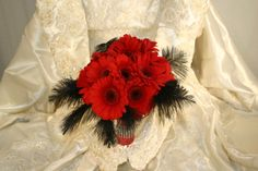 Red gerbera daisies with feathers and bling | Glamour | #bridalbouquet #60sbouquet #candelabrabouquet