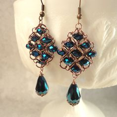 Metallic Blue Beadmaille Earrings: metallic blue crystals in diamond chainmail pattern with antiqued copper wire and jump rings. $27.00. See more at my Etsy shop: http://www.etsy.com/shop/astraeadesigns
