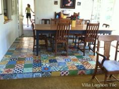 Our Colorful Patchwork cement tile in a dining room--note the step-up...the tile helps delineate the change in floor height. Villa Lagoon Tile