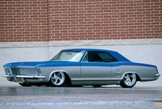 1963 Buick Riviera lowrider with chrome wheels and custom paint