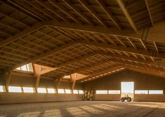Designed by Portuguese architects Carlos Castanheira and Clara Bastai, this equestrian center uses massive timber structures to house large stables and indoor riding areas. Timber Architecture, Architecture Design, Hall Construction, Indoor Arena, Timber Roof, Timber Structure, Horse Barns, Horses, Horse Stables