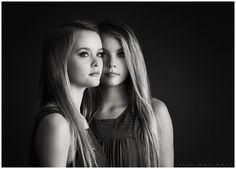 Black and white studio portrait of beautiful twin sisters. LJHolloway Photography is a Las Vegas Senior Photographer.