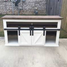 Barn door console with shelf for media controllers. Built from Ana White plans Door Furniture, Diy Furniture Plans, Farmhouse Furniture, Furniture Projects, Home Projects, Building Furniture, Farmhouse Table, Furniture Design, White Farmhouse