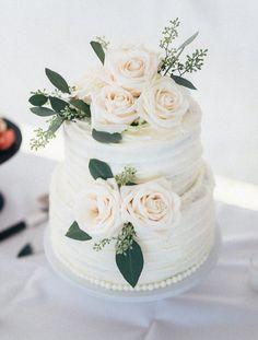 Italian cream wedding cake. Simple, elegant, two-tiered. White roses. (Waldron Photography)