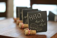 Corks can make great place card or mini food sign holders. (cut a little from the bottom)