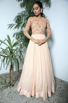 Cocktail Outfits - Nude Colored Lehenga with a Sheer Floral Embroidered Blouse | WedMeGood  #wedmegood #indianwedding #lehengas #nude #indianbride