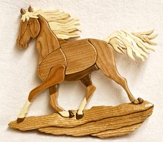 "Running horse. 37 pieces. Approx. size 8 1/2""x11"". Made of Cherry, Black Walnut, Aspen, Basswood & Oak."