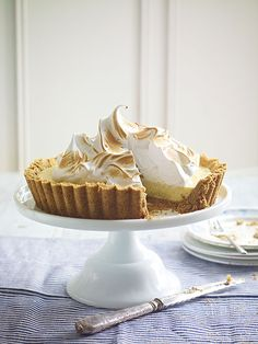 Classic key lime pie with meringue topping is an all-American dessert recipe. Fluffy meringue sits on a tart key lime pie on a lovely biscuit base.