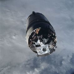"""Apollo 9, launched on March 3, 1969, was the first crewed flight of the lunar module in Earth orbit. Here the lunar module """"Spider,"""" viewed from command module """"Gumdrop,"""" awaits extraction from the third stage of the Saturn V rocket (S-IVB). 