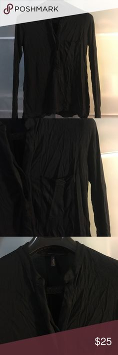 BCBG black pull on top Great condition. Small deodorant stains. Micro size whole at top Can see when on. Slight high low. Front pocket and half button up top. Great shape on BCBGMaxAzria Tops