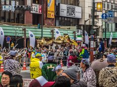 Despite the weather (overcast and cold) nearly all Asakusa gathered yesterday to catch a glimpse of the Tokyo Marathon runners; even the Golden Dragon came out of its lair for an extra dance! #Asakusa, #Marathon, #golden, #dragon February 22, 2015 © Grigoris A. Miliaresis