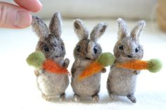 Listing is for three tiny needle felted bunnies measuring about 2 inches tall. Each holds a tiny orange wool carrot. Available with or without kraft gift box and handmade made with love gift tag.    Inspired by Beatrix Potters Flopsy, Mopsy, and Cottontail.    These miniature rabbits are made to order and so will be an individual creation just for you. Each is carefully felted from undyed grey sheeps wool fibers with some beige, dark brown, gold, and white accents. My felted animals are…