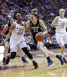 ac68f5660d4 Connecticut's Katie Lou drives the basketball up court as Florida State's  Ivey Slaughter defends in the