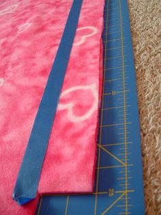 """Pieces by Polly: Single Layer No-Sew """"Braided"""" Fleece Blankets Tutorial - use painters tape to keep a straight line when using a rotary cutter to make strips on the fleece. Braided Fleece Blanket Tutorial, Fleece Blanket Edging, Knot Blanket, Flannel Blanket, Fleece Throw, Diy Tie Blankets, Fleece Blankets, Sewing Hacks, Sewing Crafts"""