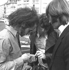 Robby Krieger, Jim Morrison and Ray Manzarek