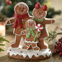 Baking gingerbread men and building gingerbread houses are fun holiday traditions. Keep them around a little longer with Kirkland's Glittered Gingerbread Family Statue. Including a mom, dad and child, this family is as jolly as can be! Gingerbread Christmas Decor, Gingerbread Crafts, Gingerbread Decorations, Christmas Goodies, Christmas Candy, Christmas Baking, All Things Christmas, Gingerbread Cookies, Christmas Time