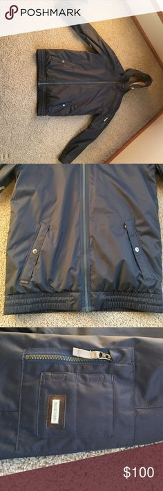 Burton Men's Chittagong Snowboard Jacket Like new! Navy blue outer shell with soft tan colored fleece lining. Many interior and exterior pockets. Front pockets zip with fleece lining. Both arms have pockets as well. My husband received this as a gift and it is too large for him.  See additional listing for more photos. Burton Jackets & Coats Ski & Snowboard