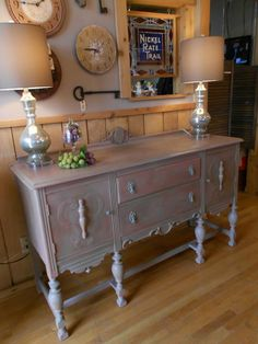 Stockist Peru Mercantile in Peru, IN shares a stylish buffet painted in Scandinavian Pink and French Linen Chalk Paint® decorative paint by Annie Sloan! It was then sealed with clear & dark Soft Wax for a beautiful finish. Doesn't it look great with those mercury glass lamps?