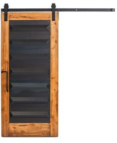 The inspiration for the Helms door is deeply rooted in medieval castles, molten ore, and strong, ancient design. We've taken those elements and created a door for today's home and office with a solid wood frame with a hand forged, ridged-steel inlay. Shown with our Clear Coat finish with Industrial Stag hanger and Angle pull.