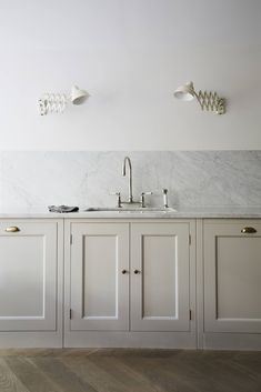 """The counters are topped with Carrara marble that continues as a backsplash. All of the faucets throughout the house are Barber Wilsons designs—and like the kitchen, the owner had them sent from London: """"You can get them in this country but I went to Holloway's of Ludlow. Even with shipping, I paid considerably less."""" (During installation, their crew consulted with the """"very knowledgable"""" Barber Wilsons customer service team based in Riverhead, New York.)"""