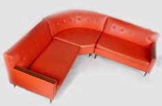 #orange vinyl sectional couch #vintage  LOL...ours was light blue with the corner sectional part in orange and cream feather looking designs!...Love it!!!...