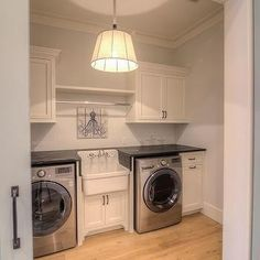 Large Cottage Laundry Room with Two Gray Barn Doors On Rails