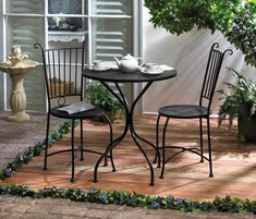 """$142.99 Lovely little table with two chairs placed just off your back door for morning coffee and the newspaper.  Or put in a more secluded spot for cocktails and late afternoon tete-a-tete.  The set includes a round lattice-top table and two matching chairs.  Metal.  Table: 27 1/2"""" diameter x 30"""" high.  Each chair: 19"""" diameter x 37"""" high.   Metal.  Weight: 28 pounds.  Some assembly required."""