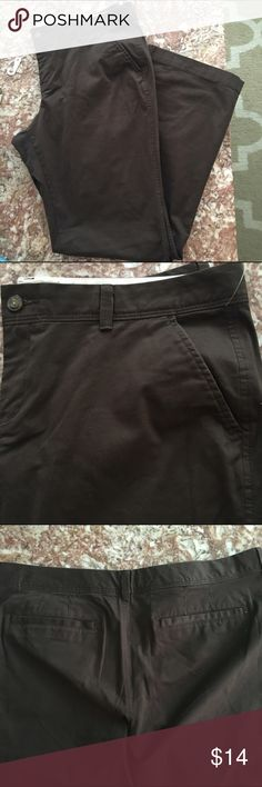 Low Rise Boot Cut Khakis A pair of brown boot cut khakis / it has two pockets in the front and in the back. There is a button. Old Navy Pants Boot Cut & Flare