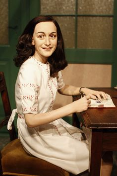 A wax figure of Anne Frank and their hideout reconstruction  is unveiled at Madame Tussauds on March 9, 2012 in Berlin, Germany.
