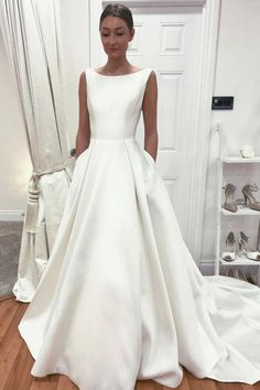 Sleeveless Satin Bride Dress with Pockets vestido de noiva 2020 from NarsBridal This+is+a+made-to-order+product. This+simple+style+wedding+gown+features+a+boat+neckline+with+sleeveless+design,+modern+. Sleek Wedding Dress, Boat Neck Wedding Dress, Simple Bridal Dresses, Plain Wedding Dress, Rose Bridesmaid Dresses, Making A Wedding Dress, Long Wedding Dresses, Bridal Gowns, Boat Neck Dress