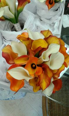 Calla lilies! Such beautiful shades of orange for a fall wedding!   Floral design by http://www.harveydesigns.com