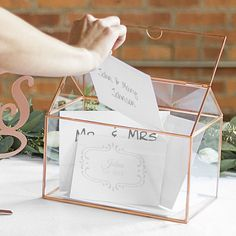 Rose gold framed glass terrarium personalized with 2 lines of custom print or a large single initial. 10 inches long by 6 inches wide by 8 inches high, constructed of nine glass panels