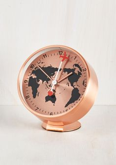 Returning home from another whirlwind journey, you snuggle into bed and set the alarm of this rose gold clock to signal the beginning of another adventure. A map print, a plane-shaped hand, and a modern design characterize this wanderlust-inspired timepiece, which keeps your sojourns right on schedule!