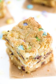 These Spring Cookie Bars are jam-packed with morsels of pastel candy and white chocolate chips. Serve up this delicious dessert recipe at your next party for a sweet treat that's perfect for a crowd.