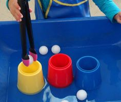 put a little water in the sensory table and then give them tongs to transfer ping pong balls into containers