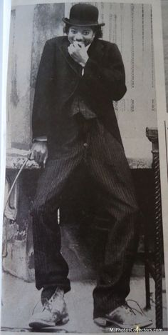 A rare photo of Michael Jackson aged 21yrs dressed as Charlie Chaplin's character - 'The Little Tramp'. Location: East Street, South London, UK - the birthplace of Charlie Chaplin. Photographed by Tony Prime, 1979.