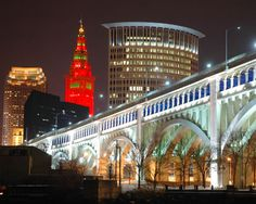 Christmas shot of the Memorial Bridge with Christmas colored Terminal Tower and Cleveland skyline from the Flats of Cleveland Cleveland Skyline, Downtown Cleveland, Cleveland Rocks, Bar Lounge, Beautiful Sites, Beautiful Places, The Buckeye State, Restaurant, Best Location