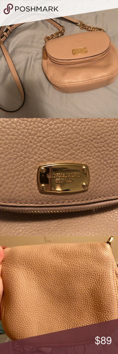 Michael Kors Crossbody Bag Blush color MK crossbody bag — a gold-tone logo plate accents the pocketed fold-over flap, and a logo-lined interior contains 1 zip pocket. Comes from a smoke-free home. Make me an offer! ***SMALL crossbody bag, there is a picture with my hand posted next to it so you can see how big it is. Last three pictures show actual color of the bag.*** Michael Kors Bags Crossbody Bags