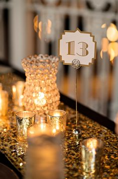 Elegant white & gold table numbers with a Great Gatsby style | Kristen Weaver Photography