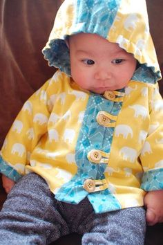Baby in the hood jacket from AMH's Handmade Beginnings (I have this book, YAY!) --- this jacket is CUTE!!   I can see it done for boys AND girls, and I just checked - it's sized for newborn right through 24 months :)