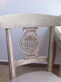 Hand carved back to vanity chair.  Also see the coordinating vanity table.