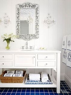 Save money and inject some personality into your bath by converting an existing dresser into a custom vanity. For a peaceful primping experience, layer a white traditional dresser against crisp white walls. A custom countertop with a fitted sink and faucet change the furniture piece's function, while a faux center drawer hides plumbing./