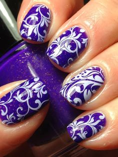Stamping nail art using Pahlish: Electrique as a base shade and Marianne plate