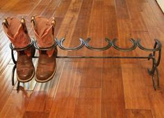 Boot stand made from horse shoes