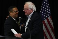 WASHINGTON, DC - DECEMBER 14: U.S. Rep. Keith Ellison (D-MN) (L) and Sen. Bernie Sanders (I-VT) (R) embrace each other during an event at the headquarters of American Federation of Teachers December 14, 2016 in Washington, DC. The event was held to outline EllisonÕs vision as he campaigns to become the next chairman of the Democratic National Committee. (Photo by Alex Wong/Getty Images)