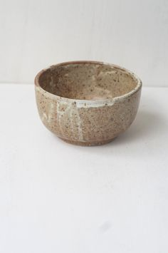 Malinda Reich Bowl no. 060 - A small bowl with a finish of sheer milky white revealing the color of the freckled clay beneath. Friend and neighbor Malinda Reich's wheel-thrown serving piece - from QUITOKEETO.com